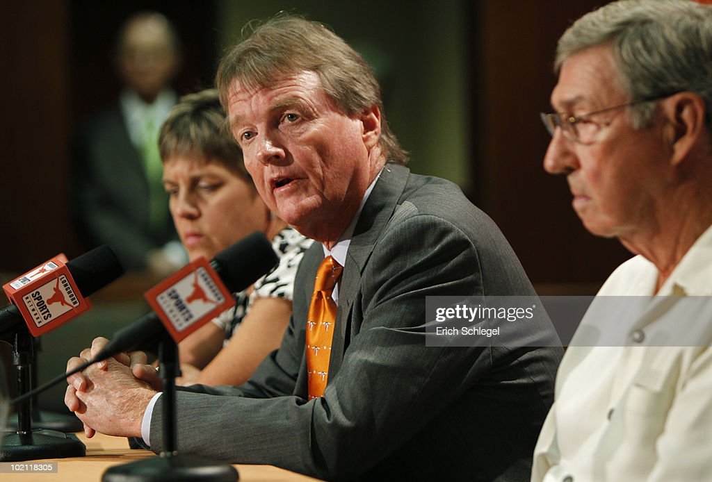 University of Texas at Austin President William Powers Jr., center, Women's Athletics Director Chris Plonskon, left, and Men's Athletics Director DeLoss Dodds, right, announce the athletics programs will continue competing in the Big 12 Conference June 15, 2010 in Austin, Texas.