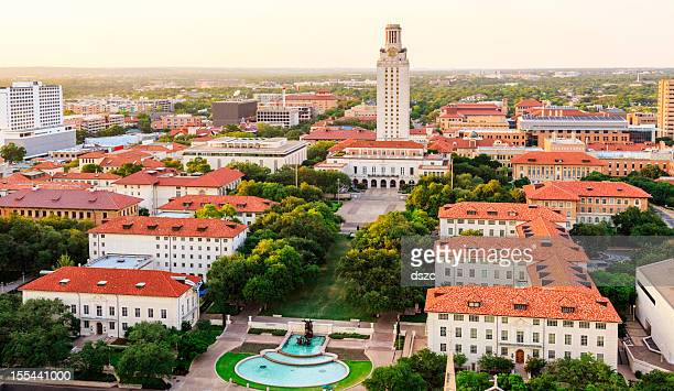 university of texas (ut) austin campus at sunset aerial view - texas longhorn cattle stock photos and pictures