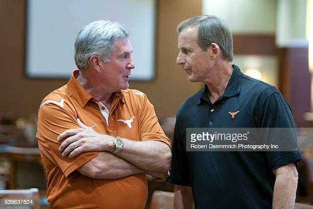 University of Texas coaches Mack Brown and Rick Barnes talk before a press conference outlining Texas' reasons for staying with the Big 12 athletic...