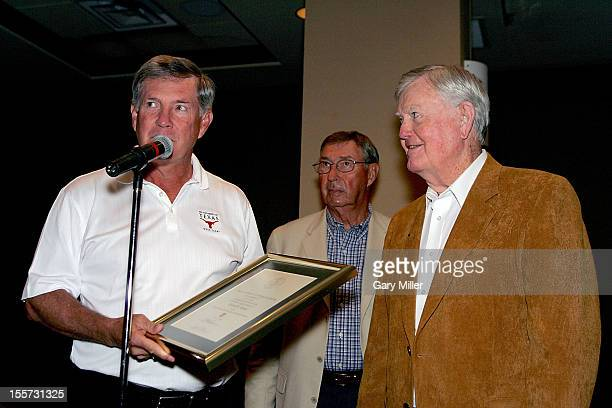 University of Texas football coach Mack Brown and Athletic Director DeLoss Dodds present Coach Darrell K Royal with a certificate recognizing his...