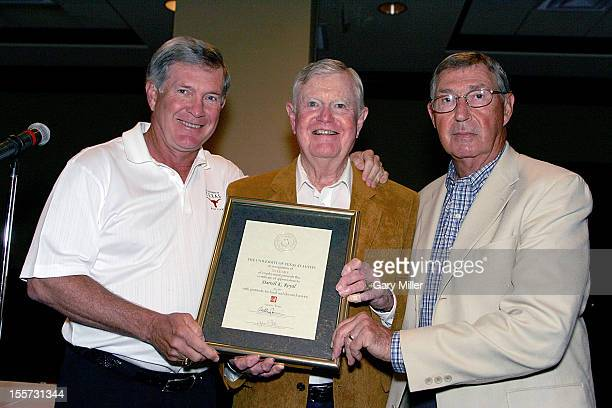 University of Texas football coach Mack Brown and Athletic Director DeLoss Dodds present former coach Darrell K Royal with a certificate recognizing...
