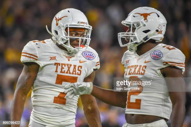 University of Texas Longhorns defensive back Antwuan Davis and University of Texas Longhorns defensive back Kris Boyd talk between plays during the...