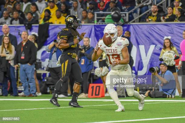 University of Texas Longhorns defensive back Brandon Jones downs a punt inside the five yard line during the Texas Bowl game between the Texas...