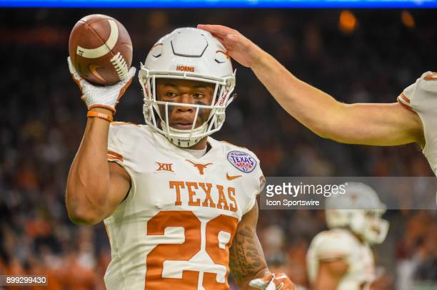 University of Texas Longhorns defensive back Josh Thompson tosses the ball to the official after downing a punt inside the five yard line during the...