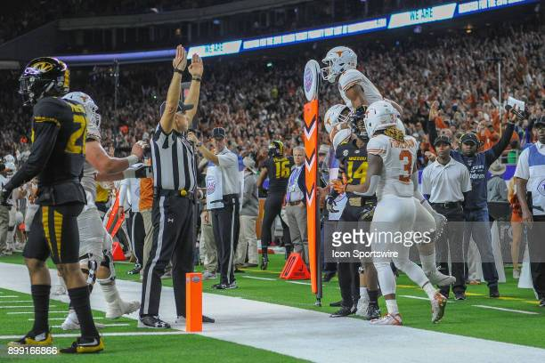 University of Texas Longhorns wide receiver John Burt is hoisted high overhead in celebration of his first half touchdown recpeption during the Texas...