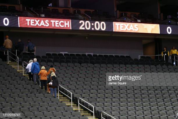University of Texas player family members leave the seating section of the Sprint Center as the tournament is cancelled at the Sprint Center on March...