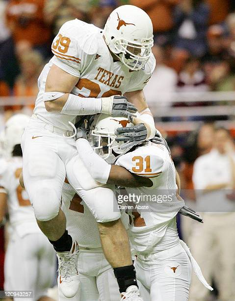 University of Texas players Brian Robison and Aaron Ross celebrate during the 2006 Alamo Bowl football game between the University of Texas Longhorns...