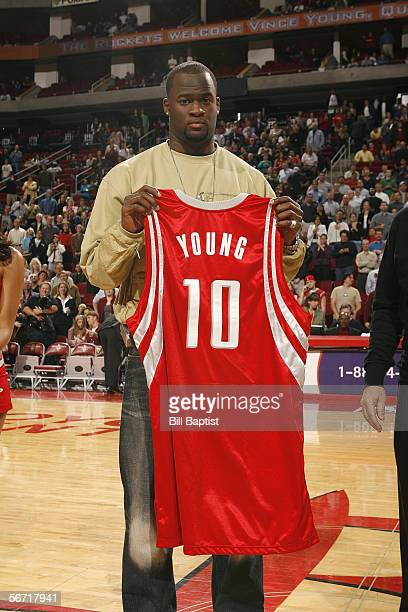 University of Texas quarterback poses for a photo with a Rockets jersey prior to the game between the Sacramento Kings and the Houston Rockets...