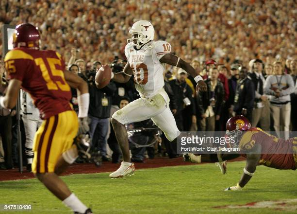 University of Texas quarterback Vince Young heads for the goal line to score the winning touchdown late in the 4th quarter as No 2 Texas beat No 1...