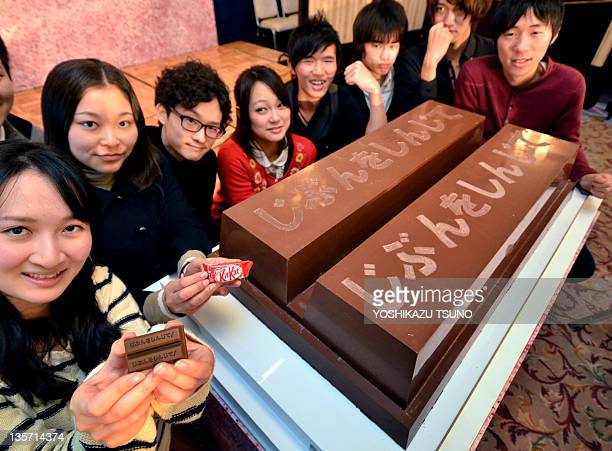 University of Tokyo students display a large sized KitKat chocolate bar, measuring 100 x 60 x 20cm and weighing 80kg, as they encourage high school...