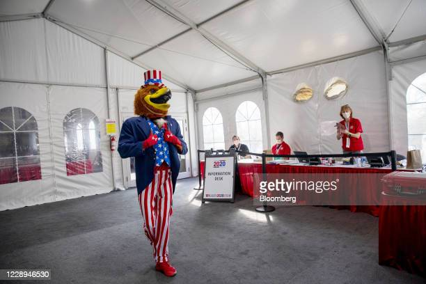 University of Utah mascot, Swoop, walks in the media tent before the U.S. Vice presidential debate at the University of Utah in Salt Lake City, Utah,...