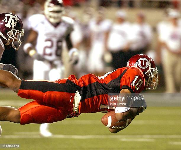 University of Utah receiver Justin Walker can't hold onto the ball as he makes a diving attempt to catch a pass thrown by Alex Smith in the fourth...