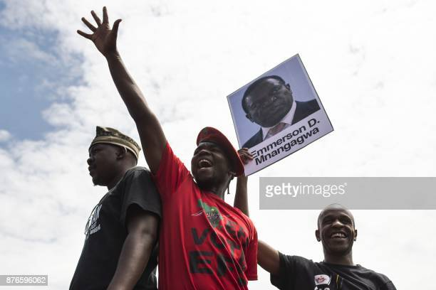 TOPSHOT University of Zimbabwe's students holding a portrait of former vice president Emmerson Mnangagwa take part in a demonstration on November 20...