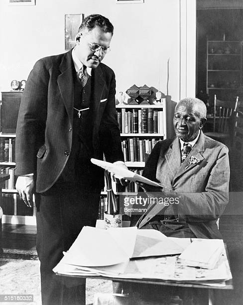 University president Frederick D Patterson and botanist George Washington Carver discuss the upcoming celebration honoring Booker T Washington...