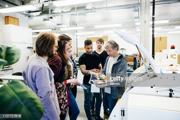 university print technician giving lab tour - printing plant stock pictures, royalty-free photos & images