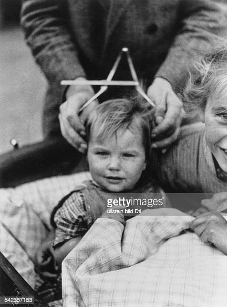 GERMANY PHRENOLOGY 1932 A university professor at an anthropological institute in SchleswigHolstein measures the cranium of a child a practice widely...