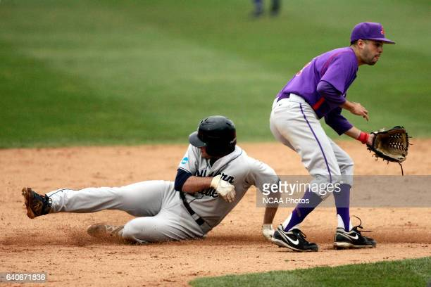 University Southern Maine base runner Chris Bernard reaches second base with a stolen base as Linfield College second baseman Michael Hopp covers in...