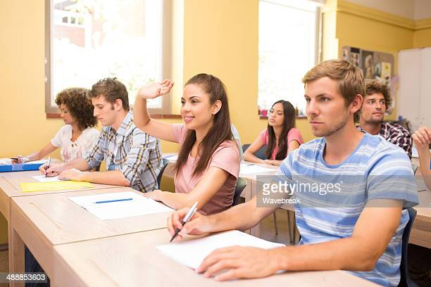 University student answering in classroom