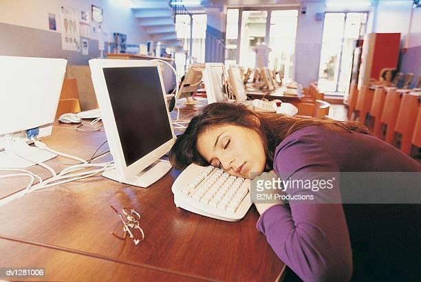 University Student Asleep on a Computer Keyboard