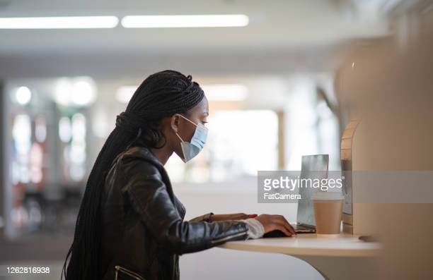 university student at work during covid-19 - university stock pictures, royalty-free photos & images