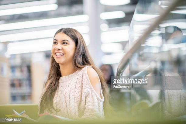 university student in the library - minority groups stock pictures, royalty-free photos & images