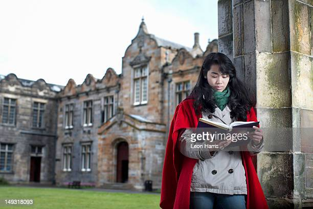 university student in traditional cape - st. andrews scotland stock pictures, royalty-free photos & images