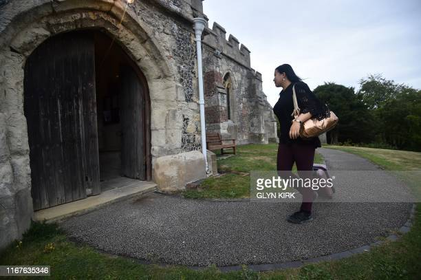 University student Kae Ono arrives at St Mary's Church where guests can pay to stay overnight in what is known as 'champing' in Edlesborough...