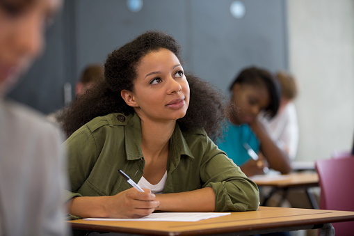 University student looking up during exam - gettyimageskorea