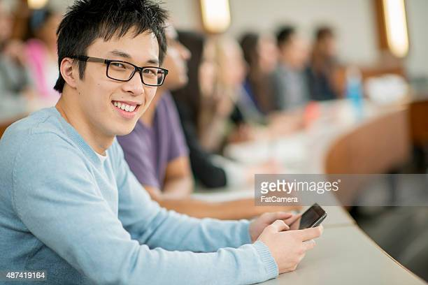 University Student on His Cell Phone