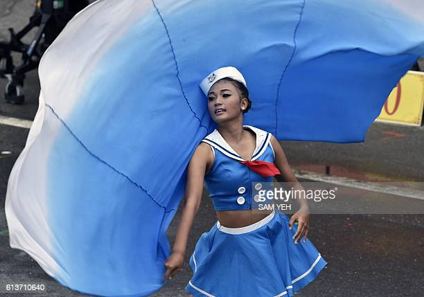 TOPSHOT A university student performs during the national day in front of the Presidential Palace in Taipei on October 10 2016 Taiwanese President...