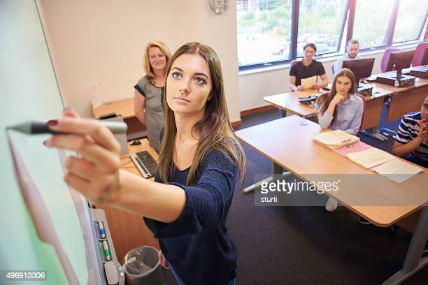 university student presenting to class