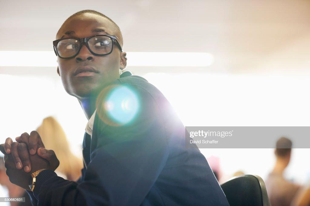 University student sitting in classroom : Stock Photo