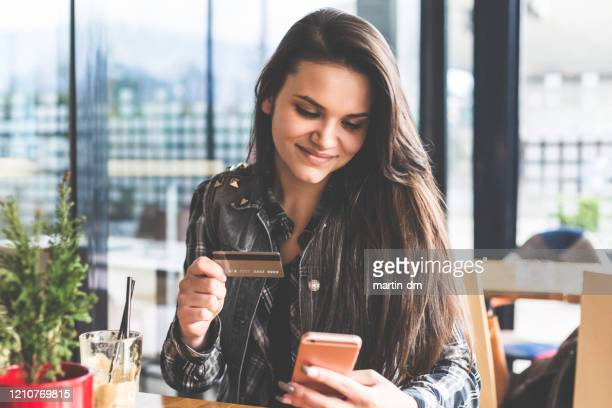 university student using electronic banking - bank account stock pictures, royalty-free photos & images