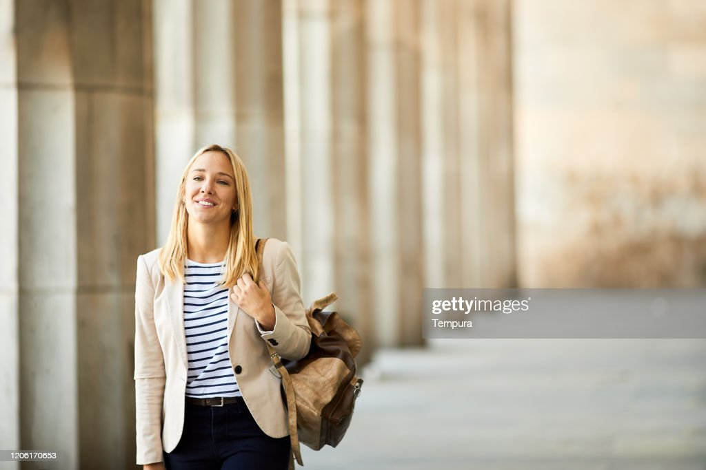 University student walking in the Buenos Aires Law school arcade facade. : Stock Photo