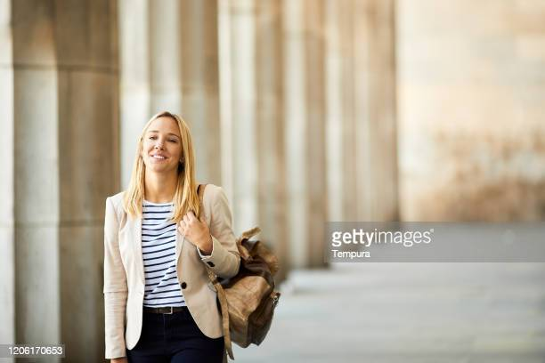 university student walking in the buenos aires law school arcade facade. - universidad stock pictures, royalty-free photos & images