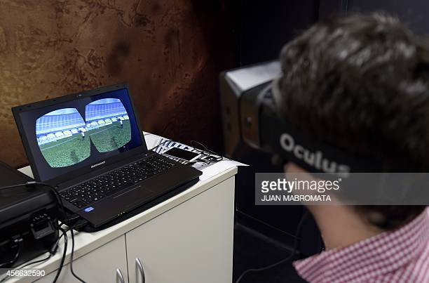 A university student wearing virtual reality goggles works in his scientist project at the computer science lab of the UADE in Buenos Aires on...