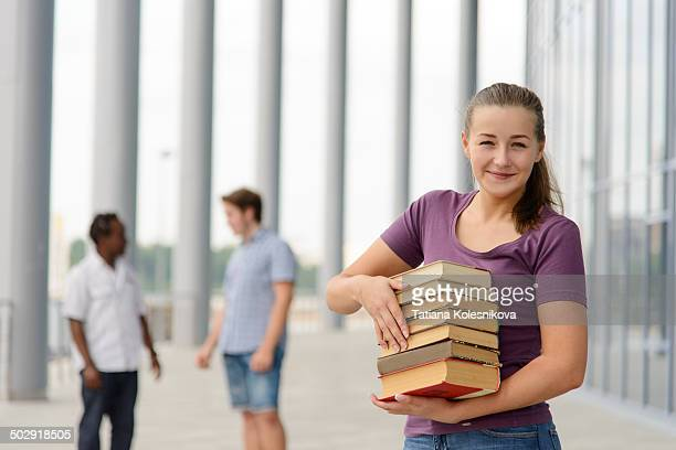 University student with a load of books