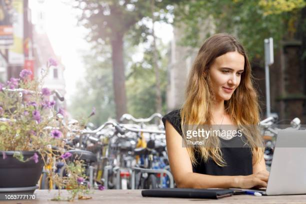 university student with laptop outdoors - flexibility stock pictures, royalty-free photos & images