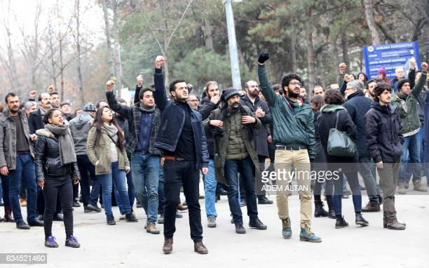 University students and academics react towards Turkish policemen at the Cebeci campus of Ankara University during a protest in Ankara on February 10...