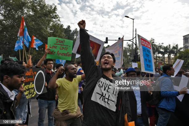 University students and professors marched from Mandi House to Jantar Mantar to protest the recent move by the government to make reservations in...