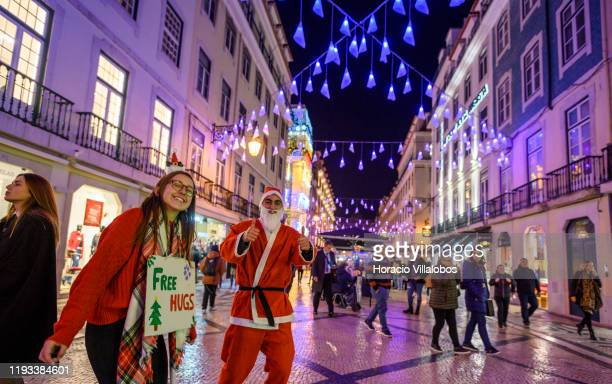 University students and tourists dance to collect money for charities in Rua Augusta under Christmas and New Year color changing illuminations on...