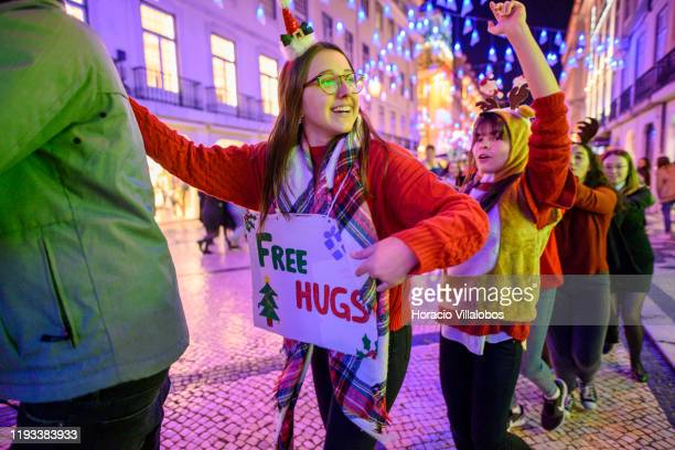 University students and tourists dance while collecting money for charities in Rua Augusta under Christmas and New Year color changing illuminations...