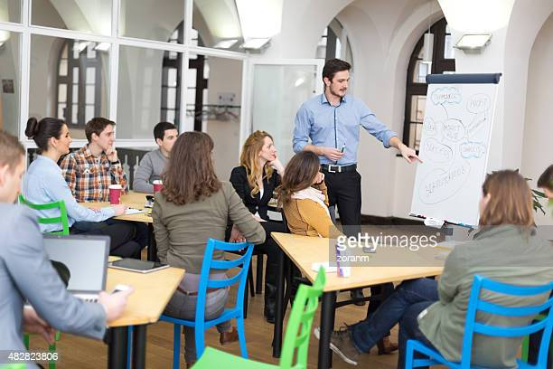 university students at lecture - staff meeting stock pictures, royalty-free photos & images