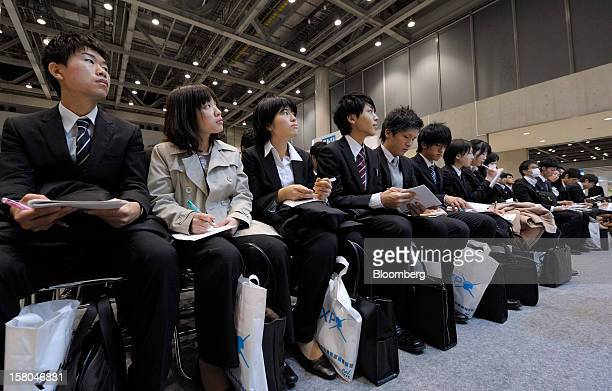 University students attend a presentation at a job fair hosted by Mynavi Corp in Tokyo Japan on Saturday Dec 8 2012 In Japan many students accept job...