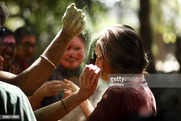 University students celebrate the festival of colour after smearing each other with coloured powder during Holi Festival in Dhaka Bangladesh 16 March...