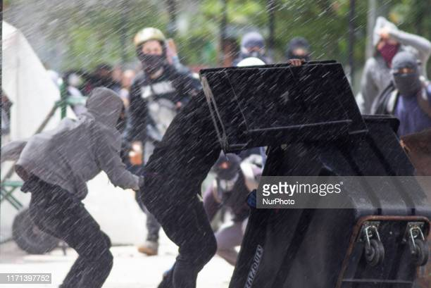 University students clash with the police during a protest in Bogota on September 26 2019