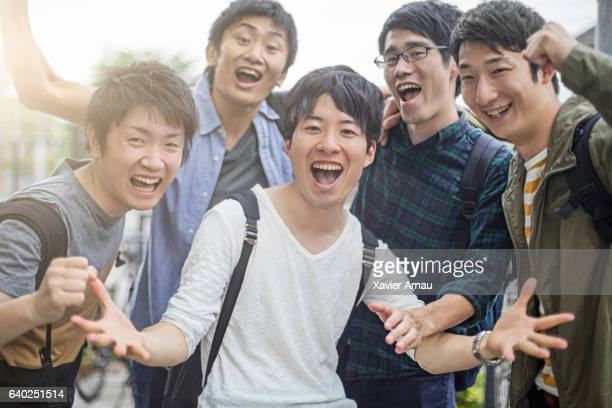 university students gesturing while screaming - cheering ストックフォトと画像