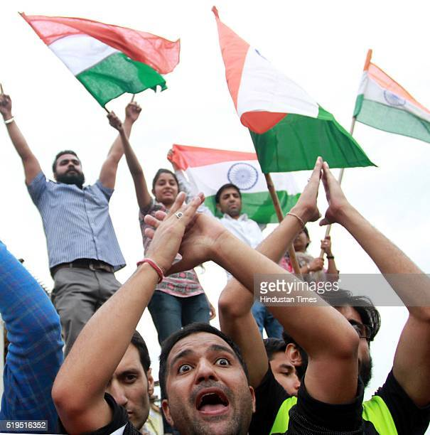 University students holding national flag as they shout slogans during a protest against ongoing unrest at the National Institute of Technology in...