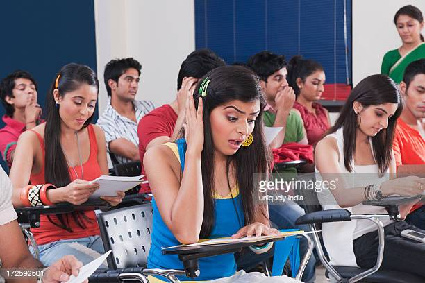 University students in a examination hall