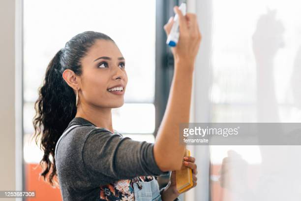university students in classroom - initiative stock pictures, royalty-free photos & images